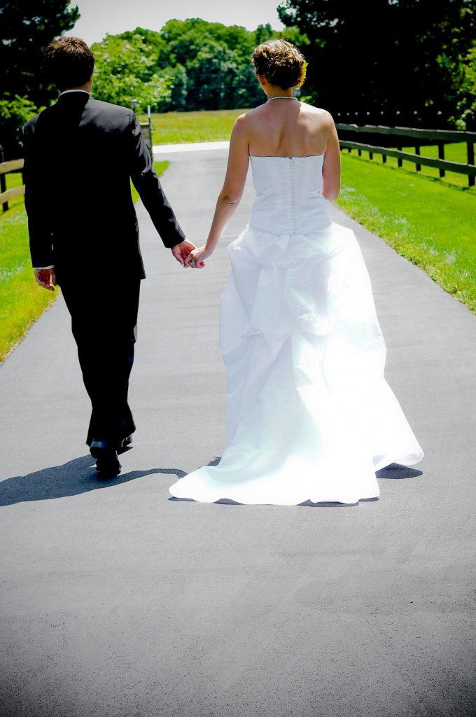 wedding husband wife walking on road