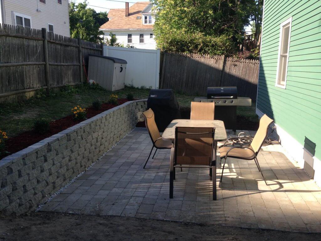 backyard patio with retaining wall