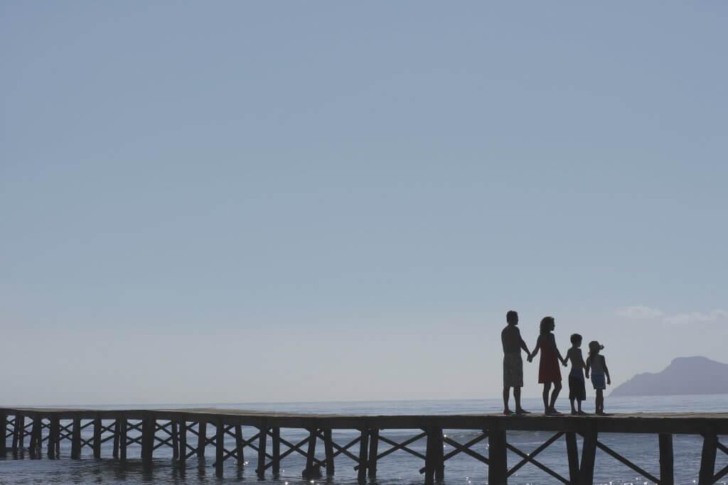 family pier water blue sky