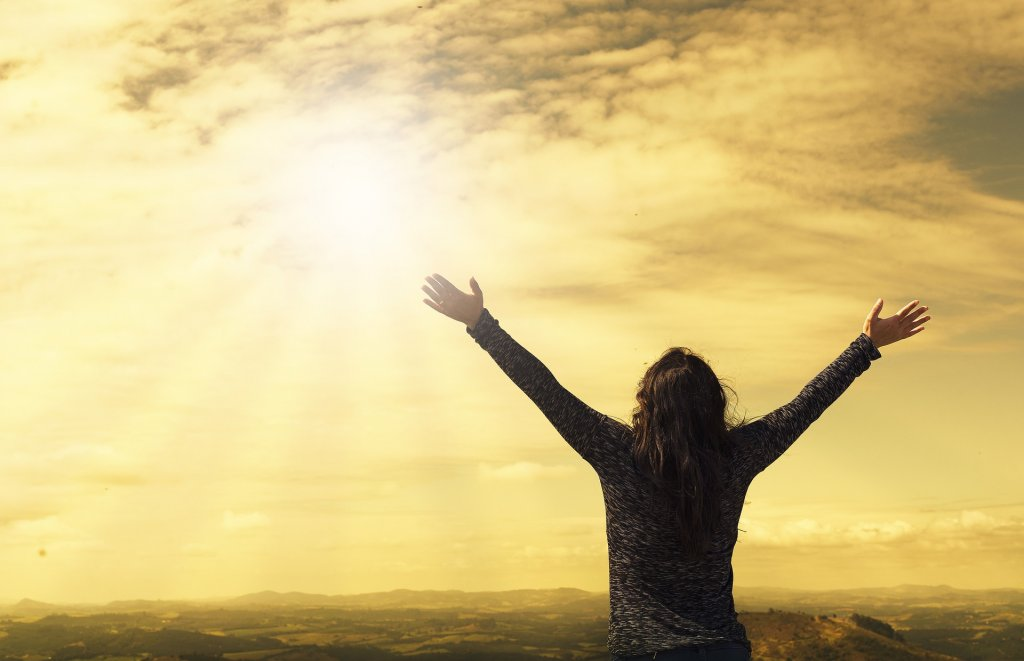 woman happy sky