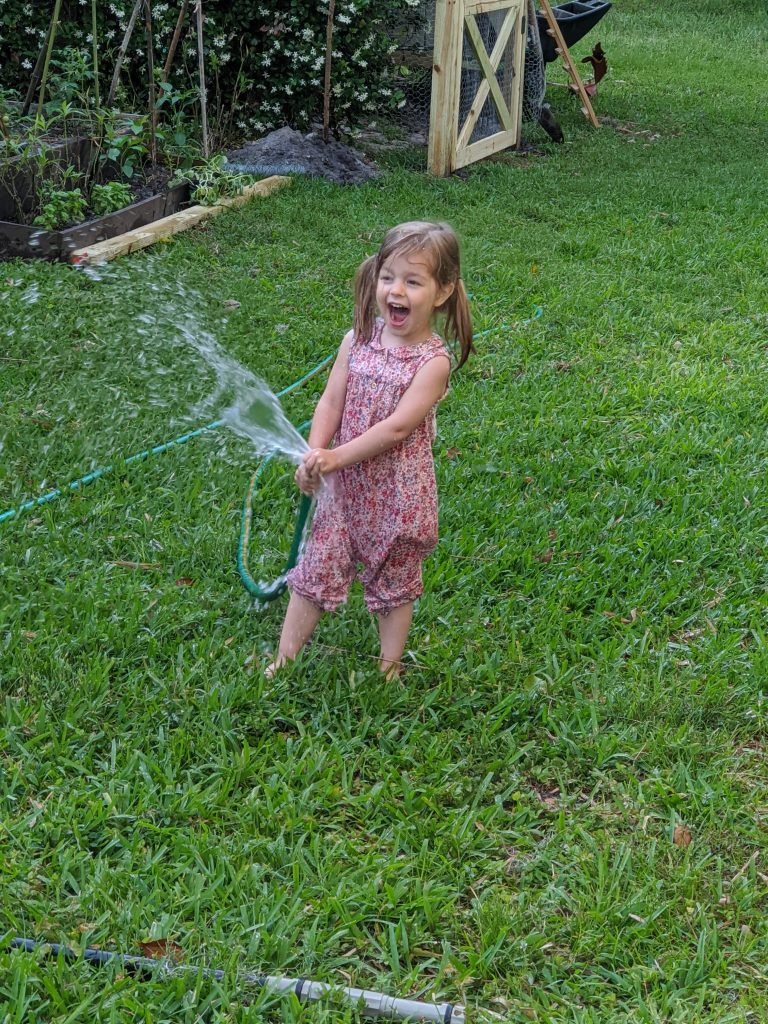 girl spraying water