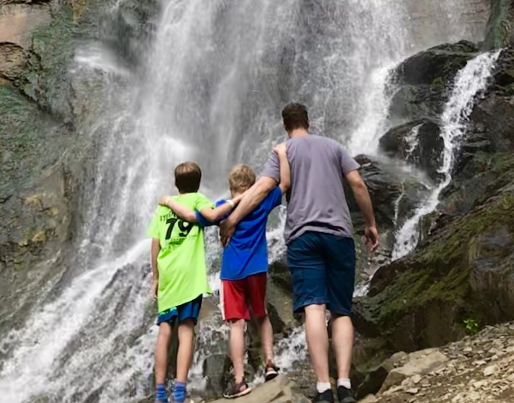 family dad kids waterfall