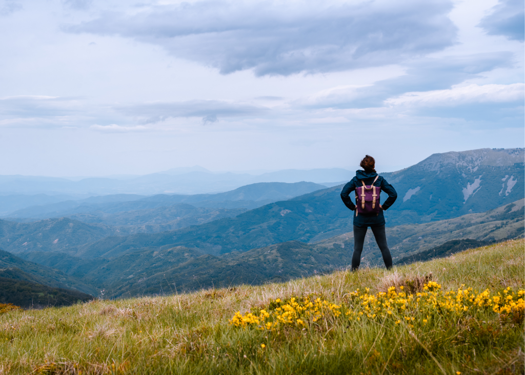 woman backpacking mountains