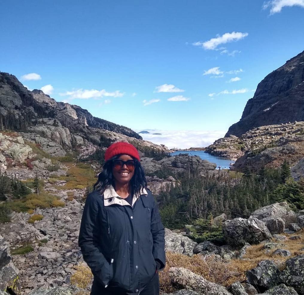 woman mountain lake