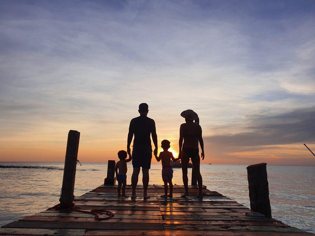 family dock sunset travel